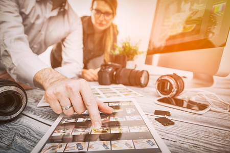 Foto de photographer journalist camera snapshot traveling teamwork team man male workroom woman female photo dslr editing edit hobbies lighting business designer concept - stock image - Imagen libre de derechos