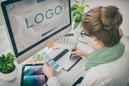 Foto de logo design brand designer sketch graphic drawing creative creativity draw studying work tablet concept - stock image - Imagen libre de derechos