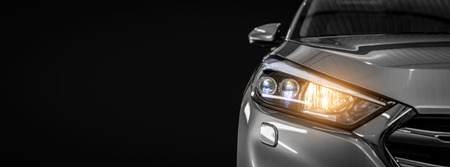 Photo pour Gray modern car closeup on black background. - image libre de droit