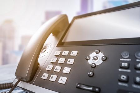 Foto de Communication support, call center and customer service help desk. Using a telephone keypad. - Imagen libre de derechos