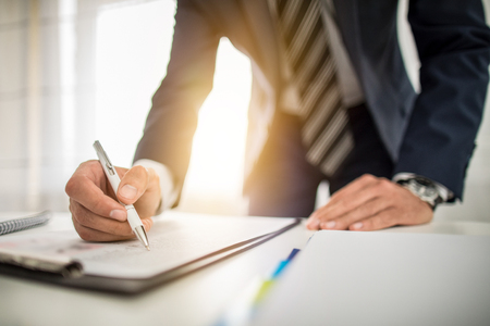 Foto per Business man signing contract document on office desk, making a deal. - Immagine Royalty Free