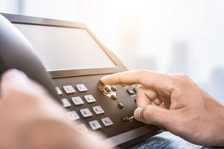 Photo for Communication support, call center and customer service help desk. Using a telephone keypad.  - Royalty Free Image