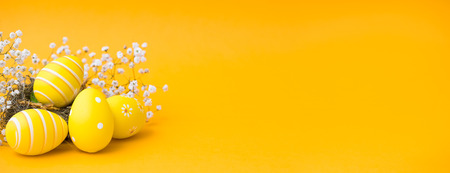 Photo for Beautiful colorful Easter eggs. Easter concept isolated on orange or yellow background. - Royalty Free Image