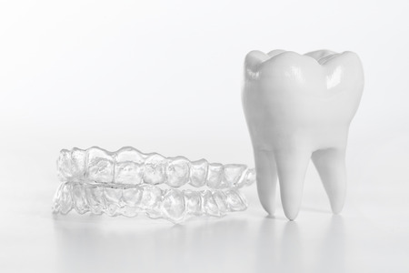 Photo pour Inivisalign braces or aligner. A way to have a beautiful smile and white teeth. - image libre de droit