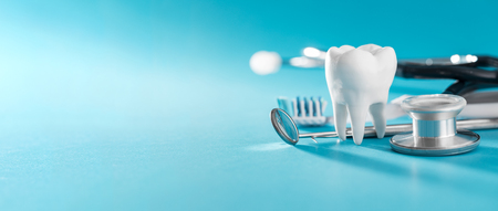 Photo for White healthy tooth, different tools for dental care. Dental background. - Royalty Free Image