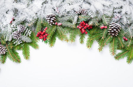 Foto de Christmas festive decoration and snow on white background with copy space for your text. - Imagen libre de derechos
