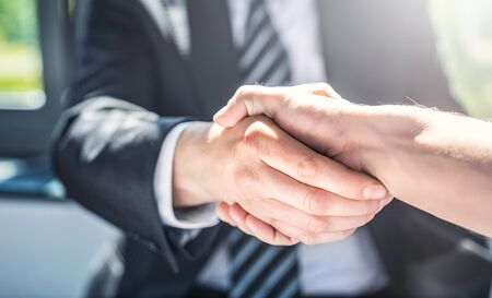 Photo for Business people shaking hands, finishing up meeting. Successful businessmen handshaking after good deal. - Royalty Free Image
