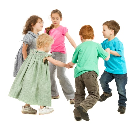 Kids holding hands and playing circle game  On white