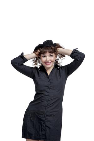 Foto de Young woman in dress with beautiful legs dancing and posing in studio - Imagen libre de derechos
