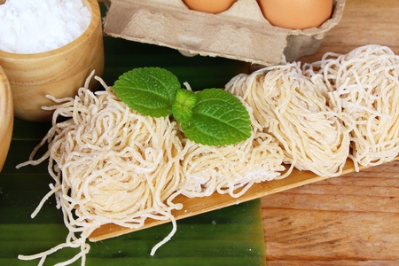 Photo for Making noodle with wheat flour and egg for cooking - Royalty Free Image