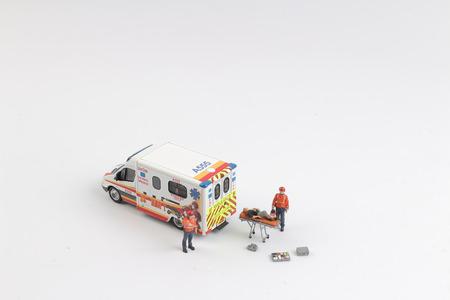 Photo pour the  Ambulance as toy car and paramedics as toy figures - image libre de droit
