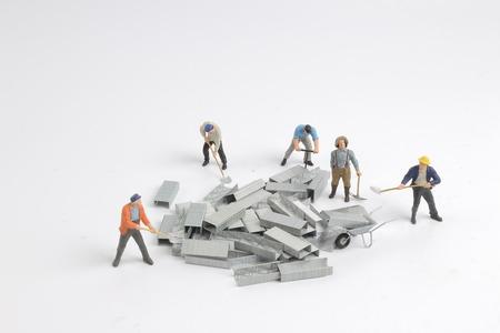 Foto de the fun of small figure move the iron - Imagen libre de derechos