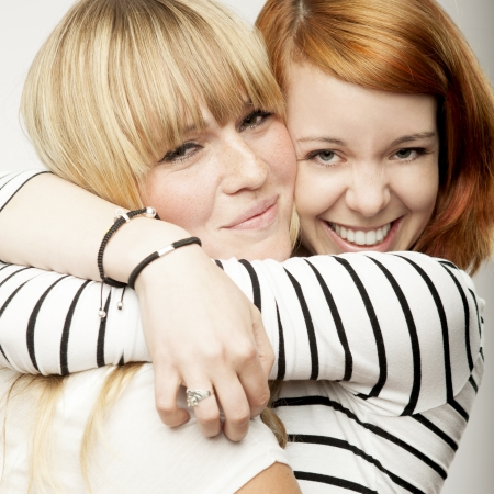 Photo for red and blond haired girls friends laughing and hug - Royalty Free Image