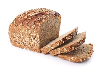 Sliced homemade brown bread with cereals. Isolated over white
