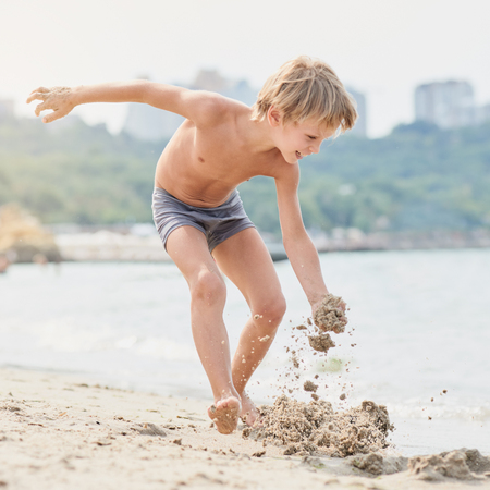 Photo for Boy playing with sand - Royalty Free Image