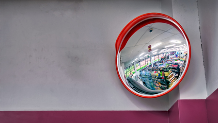 Photo pour Round Security Mirror on top of The Corner in a Convenient Store - image libre de droit