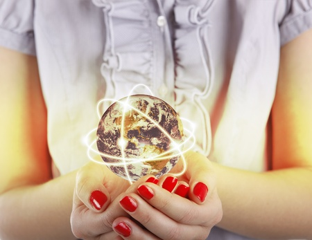 Business woman holds Earth in hands
