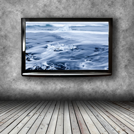 Photo for Plasma TV on the wall of the room with wooden floor - Royalty Free Image