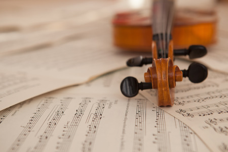Photo for Old violin lying on the sheet of music, music concept - Royalty Free Image