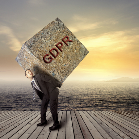 Photo for Businessman carrying heavy package - concept of GRPR - general data protection regulation - Royalty Free Image