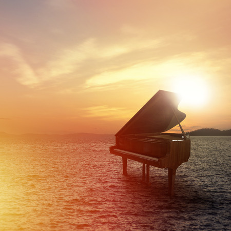 Photo for Piano outside shot at beach during sunset - Royalty Free Image