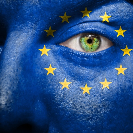 Flag painted on face with green eye to show Europe support
