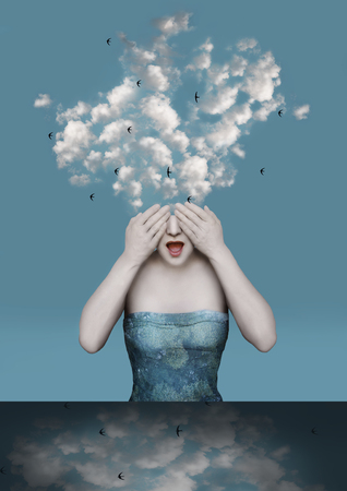 Foto de Beautiful surreal image with a girl who covers her eyes with the clouds coming out of his head - Imagen libre de derechos