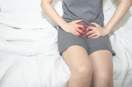 Foto de Asian women With itching Female genitalia.Itching of the female organs. - Imagen libre de derechos