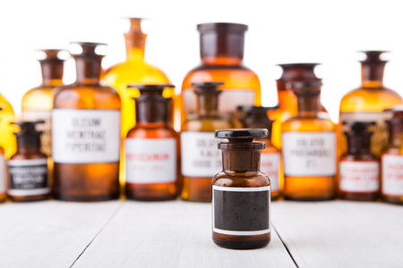 Photo for medicine bottle with blank label on wooden table - Royalty Free Image