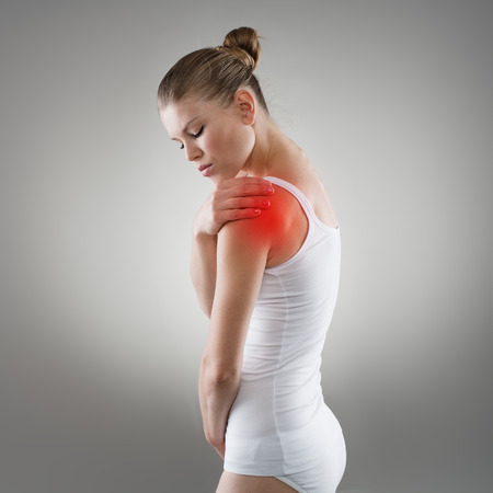 Photo pour Young woman having pain in shoulder. Joint illness or fracture treatment concept. - image libre de droit