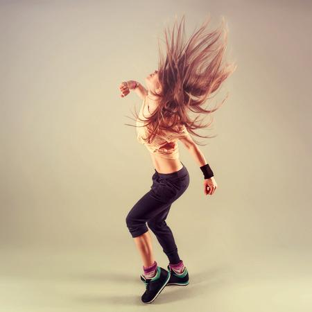 Foto de Studio shoot of active female funk jazz dancer moving. Sport and leisure concept. - Imagen libre de derechos