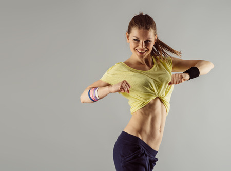 Photo for Happy hip hop dancer at workout in studio. Healthy lifestyle concept. - Royalty Free Image