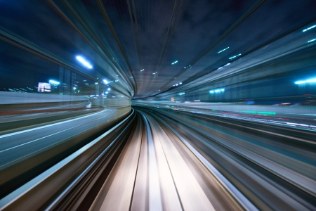 Photo for Motion blur of a city and tunnel from inside a moving monorail in Tokyo. - Royalty Free Image