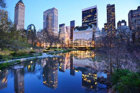 Photo for Central Park South skyline from Central Park Lake in New York City. - Royalty Free Image