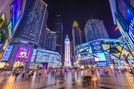 Photo for CHONGQING, CHINA - JUNE 1, 2014: People stroll through the Jiefangbei CBD pedestrian mall. The district is considered the most prominent financial district in the interior of China. - Royalty Free Image