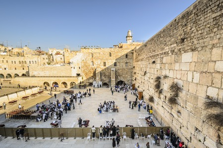 Foto de JERUSALEM, ISRAEL - FEBRUARY 20, 2012: Worshipers pray at the western wall. The wall is the most sacred site in Judaism outside of the Temple Mount itself. - Imagen libre de derechos