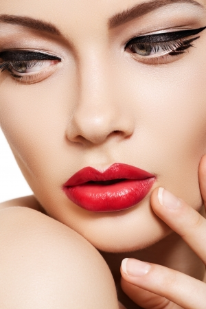 Photo for Close-up portrait of sexy caucasian young woman model with glamour red lips make-up, eye arrow makeup, purity complexion. Perfect clean skin. Retro beauty style  - Royalty Free Image