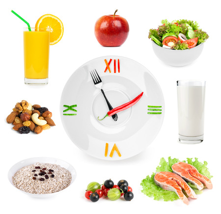 Photo for Clock with healthy diet food. Diet concept - Royalty Free Image