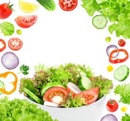 Fresh salad. Mixed falling vegetables. Food concept
