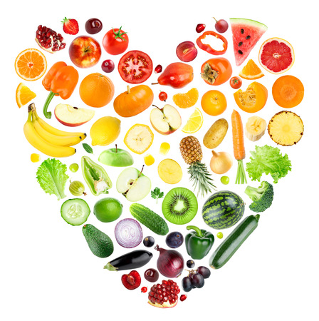Foto de Rainbow heart of fruits and vegetables on white background. Fresh food - Imagen libre de derechos