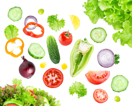Mixed falling vegetables on white background. Fresh salad
