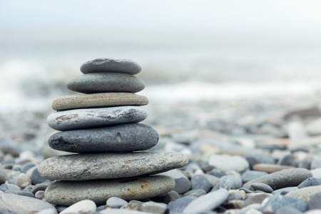 Photo pour Stack of stones on a seashore. Concept of balance and harmony - image libre de droit