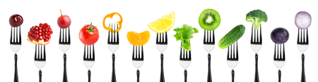 Photo pour Color fruits and vegetables on fork on white background. Fresh food - image libre de droit