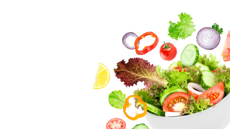 Photo pour Fresh salad. Mixed falling vegetables in bowl on white background - image libre de droit