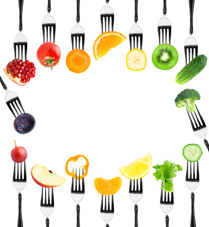 Photo pour Fruits and vegetables on fork on white background. Fresh food - image libre de droit