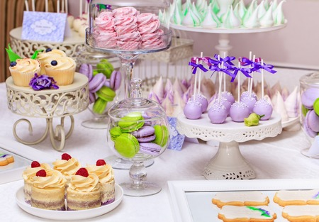 Photo for Delicious sweet buffet with cupcakes, Sweet holiday buffet with cupcakes and meringues and other desserts - Royalty Free Image