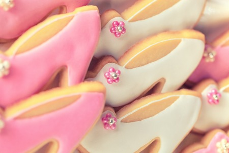 Pink and white cookies, shoe shape covered with icing