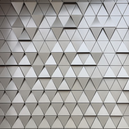 Foto de Abstract close-up view of modern aluminum ventilated triangles on facade - Imagen libre de derechos