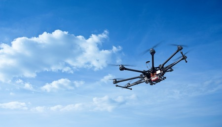 Foto de Copter flight against the blue sky. RC aerial drone. - Imagen libre de derechos
