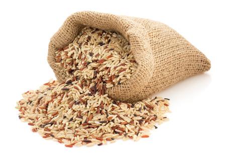Foto de rice in sack bag on white background - Imagen libre de derechos